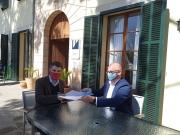 De Juan i Gelabert han signat el conveni.
